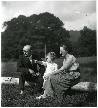 Olga Aegerter Holtkamp, Reverend Benjamin Holtkamp, and daughter, Grace, sitting down together, Helvetia, W. Va.