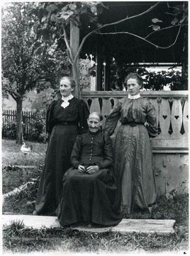Mrs. Aegerter standing on the left with Elizabeth Berger Dubach, seated in the center, who is mother of Elise Dubach Berky (Burki), standing on the right.