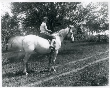 Olga Aegerter Holtkamp's daughter, Grace, on horseback.  Helvetia, W. Va.