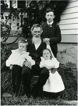 'David Kuenzler Sr. and children: Standing - David, Otto, and Frieda.'