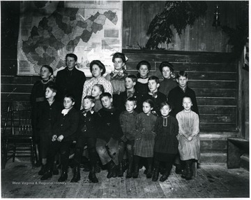 Group Portrait of Children Standing in Front of a W. Va. State Map
