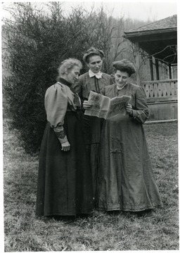 The Burky sisters (Greitly, Mary, and Elizabeth) reading a German language newspaper, Helvetia, W. Va.