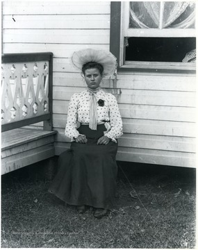 Women sitting, house in the background, Helvetia, W. Va.