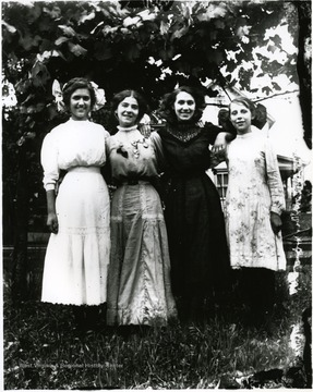 Four young women standing together under a tree, Helvetia, W. Va.