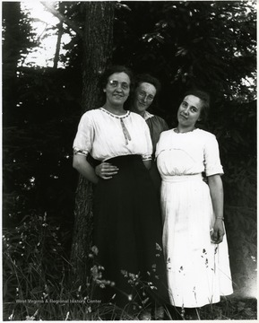 Three young women standing together under a tree, Helvetia, W. Va.