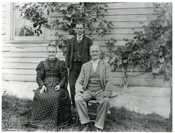 Walter Stadler is standing behind his parents, Barbara and George Stadler, near their house in Helvetia, West Virginia.