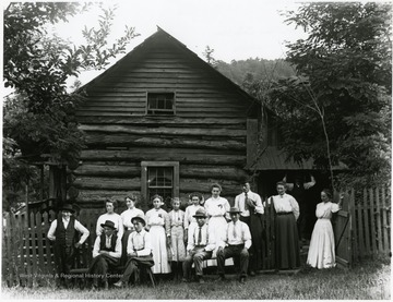 The Burky family posed for a portrait outside their cabin on Turkeybone Mountain.