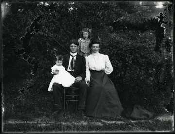 Man and woman with two children.