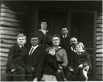 Eight people pose for a family portrait.