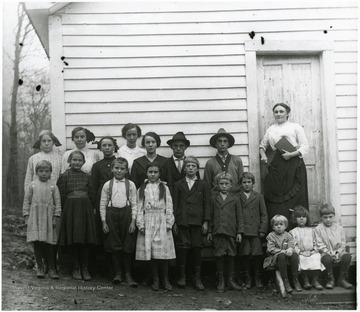 Bertha Engler taught at Fairview School, Subdistrict number 7 in Randolph County, during the winter term 1905-1906.  The school and date of this photograph is nknown.