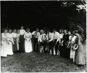 Group lined up and passing around a ball at Helvetia, W. Va.