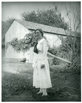 Anna Sutton is standing near a barn in Helvetia, West Virginia.
