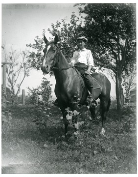 Bill Sutton sitting on a horse in a field in Helvetia, West Virginia.