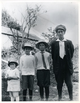 Edward Sutton, Francis Sutton, David Sutton, and Bill Sutton are standing in front of a tree.