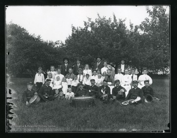 Members of the Helvetia Band with their instruments, gather outside for photograph.