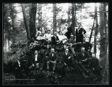 Musicians and others on an outcropping in the forest near Helvetia, West Virginia.