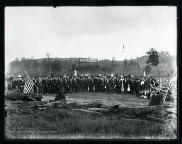 Group gathered at the Knights of Pythias Cemetery in Pickens, W. Va.  One man holds a large American flag.