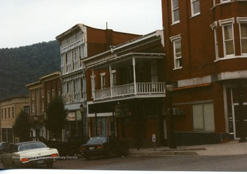 Cars parked along the street in front of downtown buildings in Hinton, West Virginia.