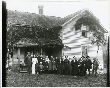 Left to Right:  Arnold Stadler, unknown man, Frieda Stadler, children Herbert and Leo Stadler in front, Gottlieb Betler, George Stadler (hat and bow tie), unknown woman, children Bertha, Louise and Lydia Stadler in front, Barbara Stadler behind in bonnet, Mrs. Dubach, Emma Stadler Burky, Katherine Rohner Stadler, Lisetta Stadler Kuenzler, Marianne Dubach Aegerter, Ida Stadler Betler, Elise Dubach Burky, Norman Stadler being held by father Walter Stadler, Fred Burky, Geottfried Aegerter - taken by Walter Aegerter on the Stadler farm October 13, 1912 (Note:  Emma's husband John changed the name from Burky to Burkey when the family moved to Ohio; the name was originally Burki.)