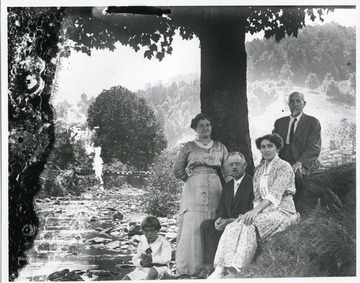 A family is sitting near a creek in Helvetia, West Virginia.