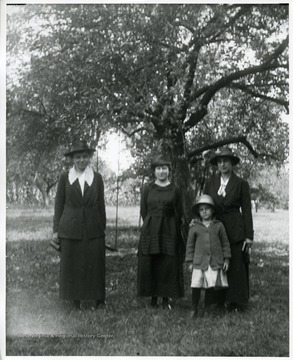 Dora Huber(left), sole African American resident in Helvetia, West Virginia, and two other woman and a child.