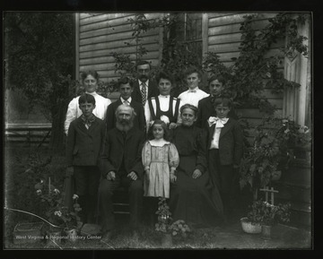 The Daetwyler Family poses for a group portrait outside their house in Helvetia, West Virginia.