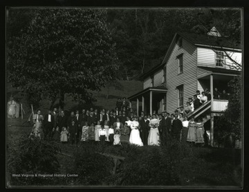 Wedding party standing near a farmhouse in Helvetia, West Virginia.