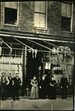 'In 1902, Huntington's Style Emporium, R. A. Jack Store, 3rd Aveune, north side, between 9th and 10th street. W. H. Newcomb at extreme right, John W. Valentine at left of doorway.'