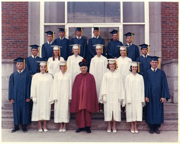Group portrait of students in caps and gowns.  John Piccolomini is standing in the third row.