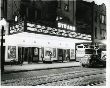 A scene in front of the Strand Theater in the 1940's. Located on Market between 4th and 5th in Parkersburg, West Virginia.