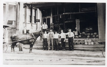 'Gorby Brothers Grocery Store, early 1900's. Located on the south side of North Street near Maple Avenue, New Martinsville, West Virginia. Left to right: unknown, Charles Thomas Gorby behind horse's collar, unknown (in back), Front: unknown, William Edward Mullett, unknown, Kersey Jesse Gorby, George Ira Gorby.'