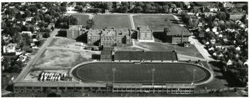 Aerial view of Parerksburg High School with football field right beside the school.