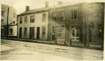 'Old Weston - Left - Bailey House - Baily House Barber Shop - bill board - Allen Simpson property now torn down 'in this building Er Ralston opened 1856' and next the Fisher property - later Weston Independent.'