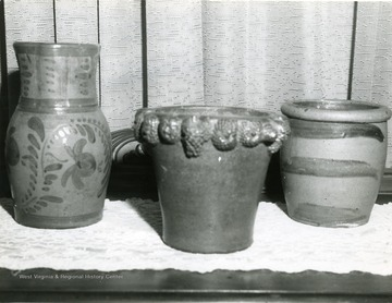 Three clay pots.