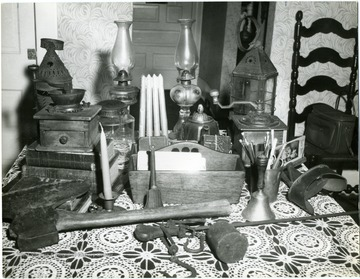 A group of antiques on a table.