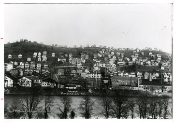 'Worker housing climbs up the hill of Seneca in the early 1900's, as the neighborhood grows around the glass factories.'
