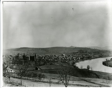 A view of Morgantown, West Virginia in 1895. West Virginia University and several houses can be seen near the Monongahela River; original Monongalia County Historical Society through Mrs. Mabel Stoyer.