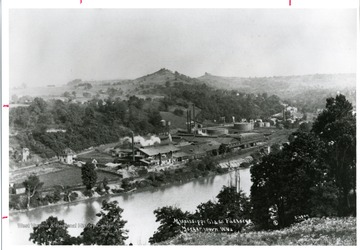 'The Mississippi Glass Factory in South Morgantown. Dorsey's Knob can be seen in the background.'