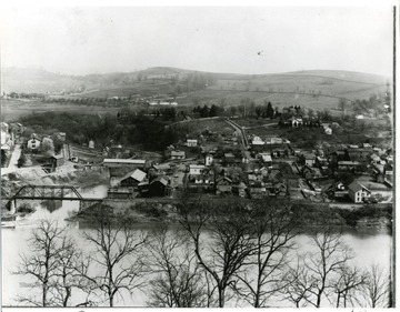 'Portion of a panoramic view taken in 1894. A covered bridge, crosses Decker's creek at South High.'  See image 008078 for other portion of image.