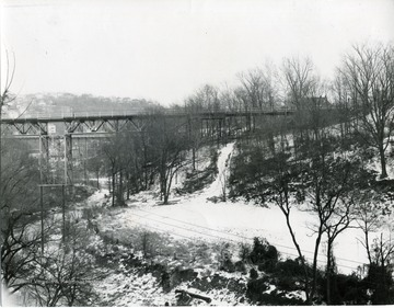 View of Deckers Creek and the Walnut Street bridge on a snowy day.