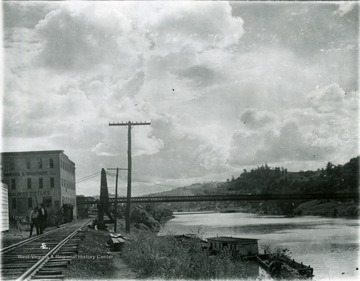Suspension bridge known as 'The River Bridge'. View of the railroad trestle at the foot of Walnut Street.