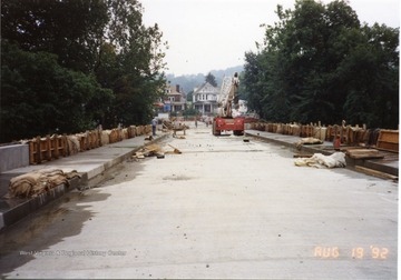 Nearly completed South Park bridge. Equipment and one worker can be seen. Also, scrap material can be seen.