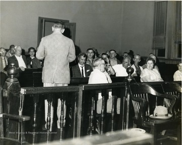 William Delardas giving addressing crowd in the old court room in Morgantown, W. Va.