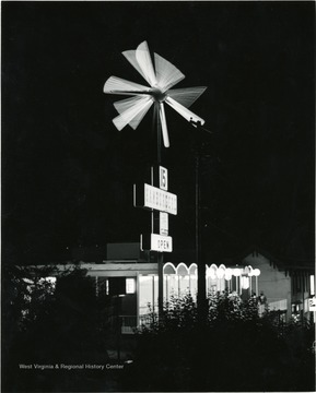 Burger Boy's Food-A-Rama restaurant where hamburgers were $.15, as it appeared at night. Sign was lit and in motion.