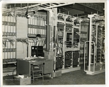 An employee is working at the new Telephone Exchange in Morgantown, West Virginia.