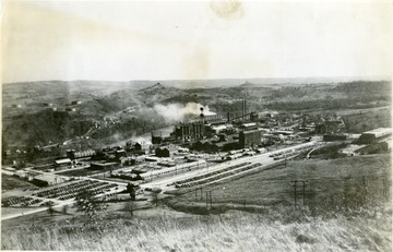 'Dupont Chemical Company, now Morgantown Ordnance Works.' A few houses surround the plant. The river is located on the far side of the plant. Automobiles can be located in the parking lots.