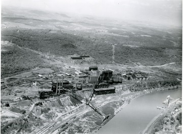 Aerial view of Morgantown Ordnance Works located in Morgantown, W. Va. River seen near plant.