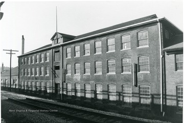 'Original woolen mill portion of building view facing west along Rail Road.'