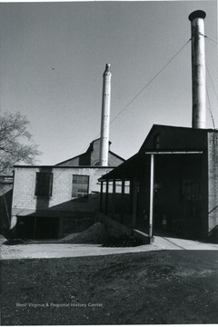 'View from river side looking north at end of factory showing additions.'