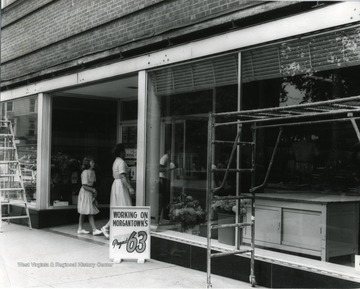 Shoppers entering Montgomery Ward in Morgantown, W. Va. During Project 63 maintenance.